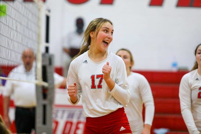 Crestwood sophomore Aimee Barnauskas celebrates after a point during the team's first-round OHSAA tournament match against Champion High School.