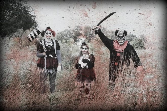 "A group of ""clowns,"" from left, Amanda Mitchley, Kloee Mitchley and JJ Mitchley from Suffield, are ready to scare visitors to the ""Haunted Trail"" in Suffield"