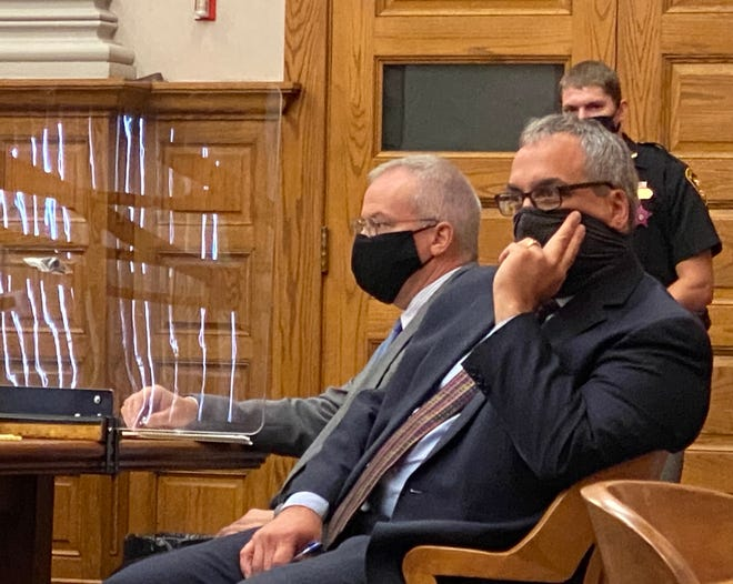 John Sohar (left) and attorney George Urban listen to juror instructions on Thursday morning in Stark County Common Pleas Court. Sohar, 52, of Lexington Township, is on trial for allegedly sexually assaulting a 14-year-old girl in his therapist role.
