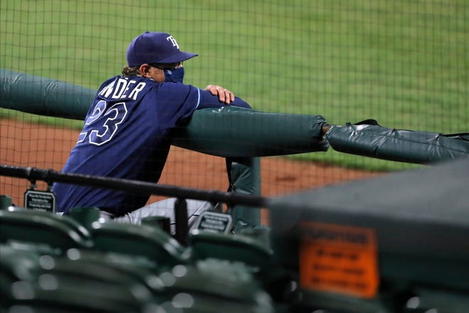 Tampa Bay Rays pitching coach Kyle Snyder looks on from a photographers' pit next to the dugout in this Aug. 1 file photo. Snyder, a graduate of Riverview High School in Sarasota, won a World Series ring in 2007 while playing with the Boston Red Sox.