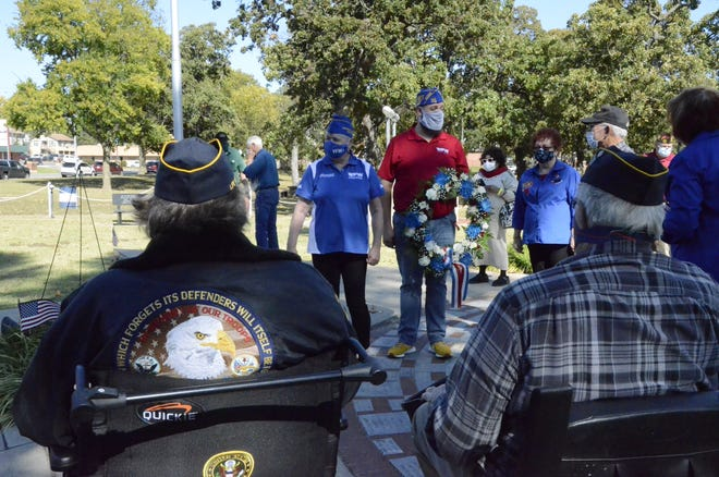 National VFW official lays wreath at Veterans Memorial