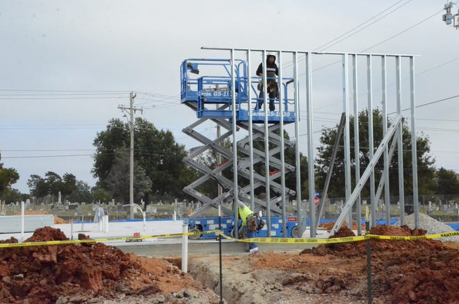 At the northwest corner of Grant and Harrison, the space shows signs of framing beginning for a new medical building.