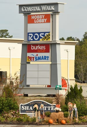 Some of the stores at the Coastal Walk Marketplace in Shallotte. [KEN BLEVINS/STARNEWS]
