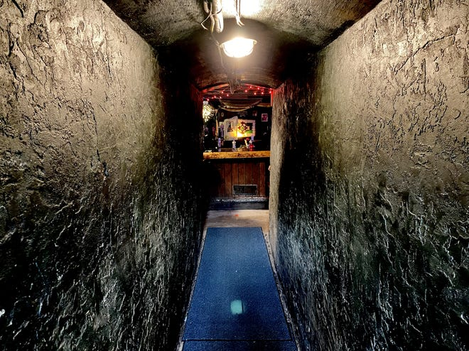 The entrance to Lula's A Pub in downtown Wilmington is a favorite spot for local supernatural aficionados, as the dark hallway leads into the underground bar.