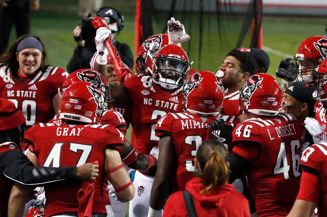 N.C. State linebacker Jaylon Scott (2) celebrates with the 'Turnover Bone' after making an interception during the second half of N.C. State's 31-20 victory over Duke at Carter-Finley Stadium in Raleigh, N.C., Saturday, Oct. 17, 2020.