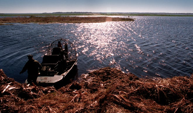 An airboat and pilot at Orange Lake are seen at an artificial island meant to become a haven for wildlife in this undated file photo.