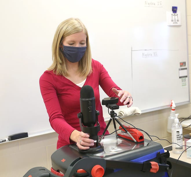 Claymont High math teacher Shawna Hupp sets up the web cam and microphone she uses to do videos used in remote instruction.