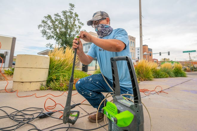 Dylan Weingardt puts a pressure washer together at Central Plaza as part of the Impact Youth Initiative and Pueblo Arts Alliance beautification project.