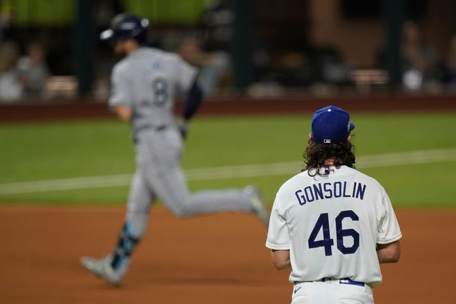 Tampa Bay Rays' Brandon Lowe rounds the bases after a home run off Dodgers starting pitcher Tony Gonsolin during the first inning of Game 2 of the World Series on Wednesday, Oct. 21, 2020, in Arlington, Texas.