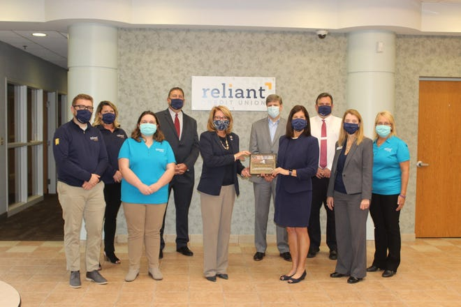 State Sen. Pam Helming, R-54th District, presents the New York State Senate Empire Award to Pamela Heald, president and CEO of Reliant Credit Union, and employees in recognition of the company's 50th anniversary.