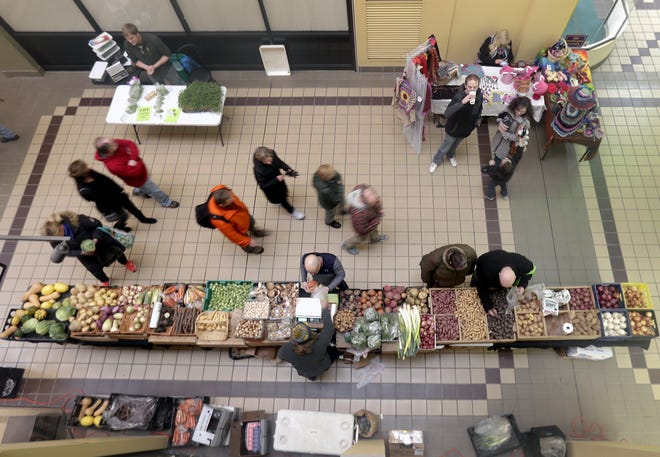 In this archived photo, shoppers browsed displays of handmade goods and fresh produce in the Downtown Appleton Indoor Farm Market inside City Center Plaza. The indoor market has been cancelled for the 2020/2021 winter season.