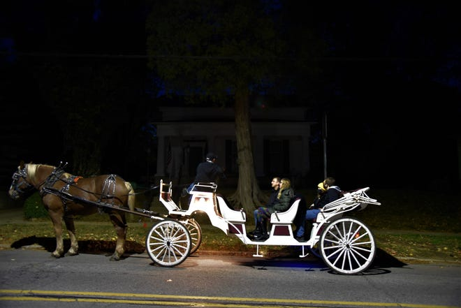 Dennis McKeen of Marshall Carriage Co. & Ghost Tour tells a story in front of the Governor's Mansion at 621 South Marshall Ave. on Wednesday, Oct. 21, 2020.