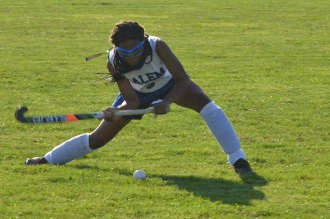 Salem senior Destiny LeFlore sends a drive to a teammate against Woodstown.
