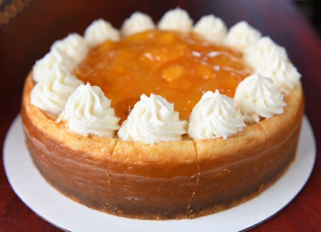 A peach cheesecake is displayed at Yhanne's House of Cheesecakes in Clayton, NJ.