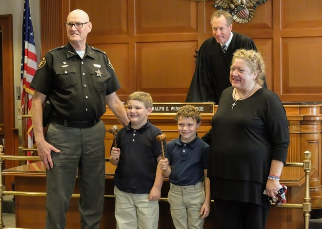 Hamilton County Sheriff Jim Neil and his wife, Kim, adopted two boy Thursday after raising them for more than five years.