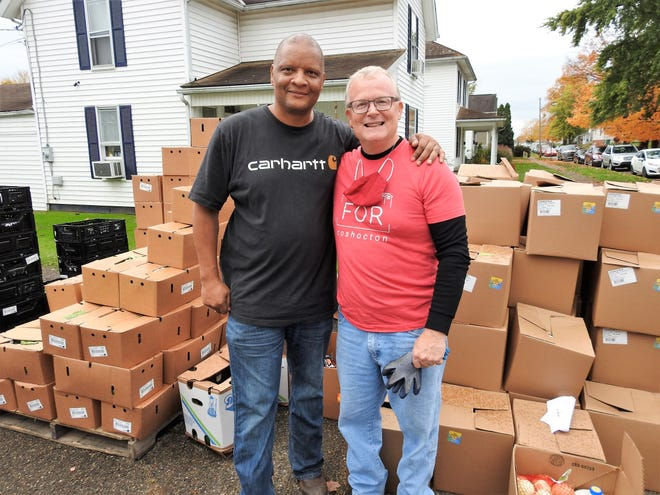 Pastor Stan Braxton of Upper Room Assembly and Worship Center and Pastor Rob Campbell of NewPointe Church of Coshocton have brought their congregations together for a food distribution program. On Wednesday, they unpacked about 60,000 pounds of food that will go out to 500 families.
