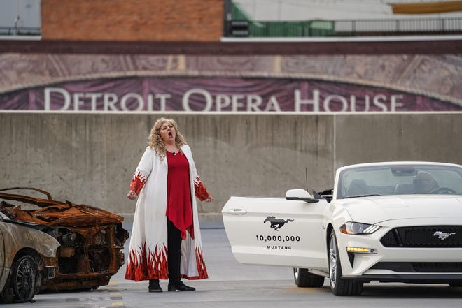 """Soprano Christine Goerke played the role of Brünnhilde during a drive-in opera performance of """"Twilight: Gods"""" in the Detroit Opera House parking garage last October. Groups of vehicles made their way through the structure as singers performed 10-minute scenes from the opera on various levels."""