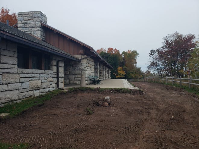 A historic 400-ton pavilion that offers spectacular views of Lake Michigan will be moved away from an eroding bluff after a mudslide and high water levels last year threatened to destroy the structure.