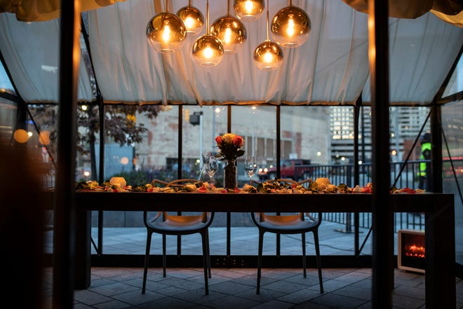 A table set for customers a heated outdoor seating area at Lumen near Beacon Park in downtown Detroit on Oct. 21, 2020.