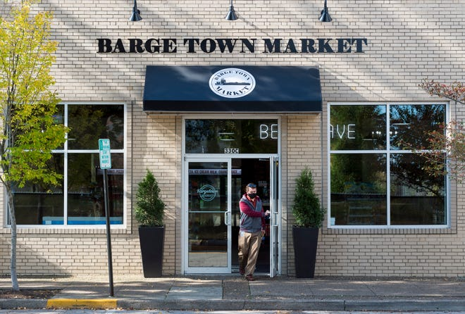 A customer exits the new Bargetown Market located on Fourth Street in Downtown Evansville Thursday morning, Oct. 22, 2020.