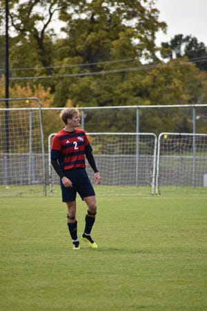 USI's Markus Poulsen plays in a match for the Screaming Eagles. Poulsen, a defender, played soccer for USI for three seasons.