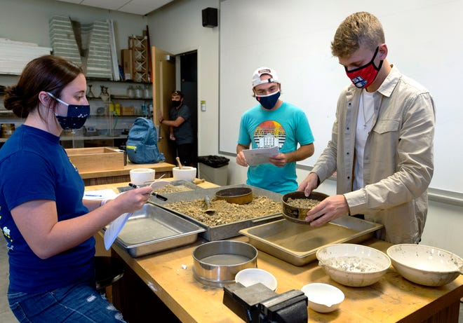 Runner Markus Poulsen, right, works on the Atterberg limit lab with classmates Lauren Melchior, left, and Zachary Breault, center, in their Soil Mechanics class at the University of Southern Indiana Wednesday, Oct. 14, 2020.