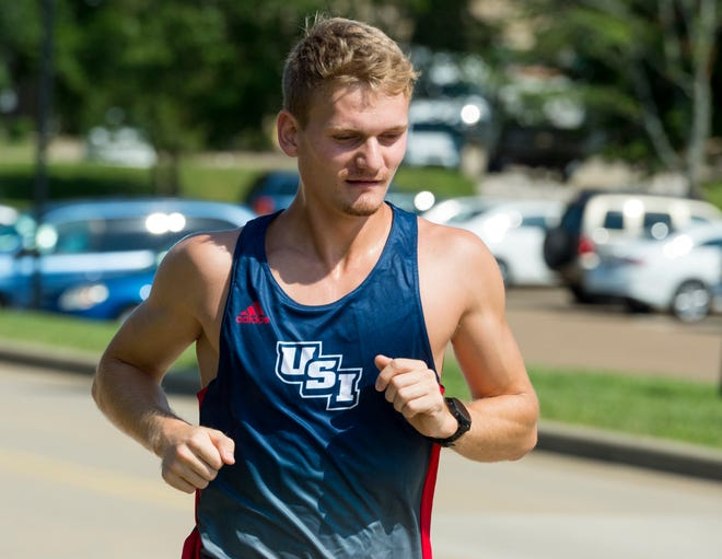 University of Southern Indiana runner Markus Poulsen runs his typical route around campus Tuesday, Sept. 8, 2020.