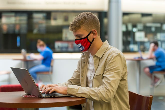 University of Southern Indiana runner Markus Poulsen waits for a class in the Business and Engineering Center Wednesday, Oct. 14, 2020.