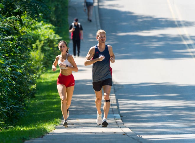 University of Southern Indiana runner Markus Poulsen, right, runs through campus housing with his girlfriend Megan Wagler, Tuesday, Sept. 8, 2020.
