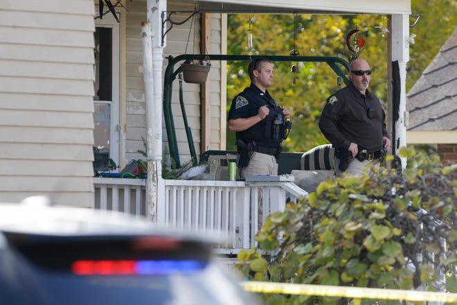 Police investigate a house at the corner of North Range and West School Streets where two males were found dead inside, Thursday, Oct. 22, 2020 in Wolcott.