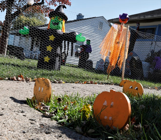 A house on Cherokee Drive in Lancaster is in the Halloween spirit, decorated with jack-o-lanterns, inflatable witches and completed with an inflatable cemetery.