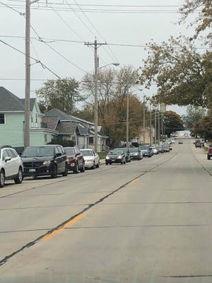 Vehicles line the street waiting up to two hours before Grow It Forward's pantry opened