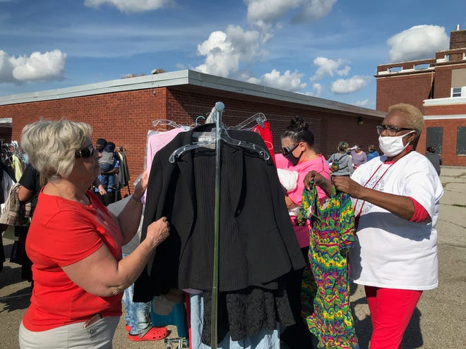 Willa King, left, and Pam Rembert of Children's Cupboard, said the nonprofit organization is looking for a new home. A clothing giveaway was held Thursday outside Hedges School.