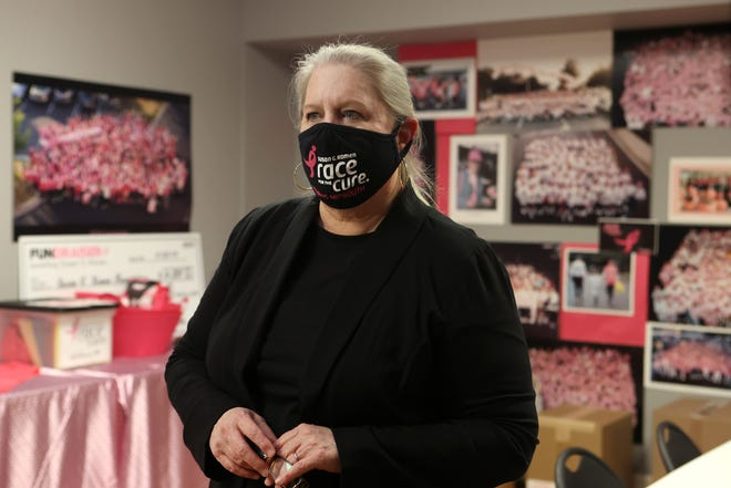 Elaine Hare, chief executive officer of the Susan G. Komen Memphis-MidSouth Mississippi, inside her Germantown office on Thursday, Oct. 22, 2020.  Photos of the organization's Race for the Cure hang on the walls behind her, representing their largest annual fundraiser which this year will become virtual as a safety precaution because of the pandemic.