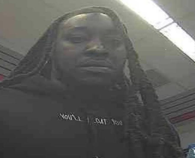 Postal inspectors are searching for information about this person of interest suspected of being connected to a mail fraud and theft case.