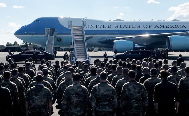 Military personnel and others await President Donald Trump from Air Force One for the final presidential debate at the Curb Event Center at Belmont University in Nashville, Tenn., Thursday, Oct. 22, 2020.