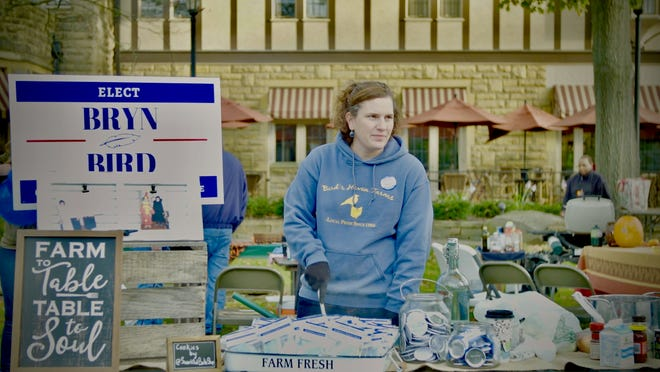 Bryn Bird is seen in this production still from the new documentary campaigning at a community event in front of the Granville Inn.