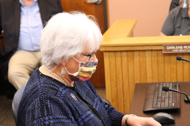 State Rep. Cathrynn Brown looks over notes during the Oct. 20, 2020 Eddy County Commission meeting. She provided an update on legislation she's working on for the 2021 New Mexico Legislative Session.