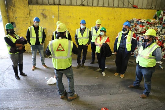 Members of the city's administration and council visiting the recycling processor the city uses.
