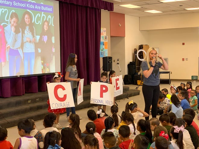 Katie Welch (with mic) and Solange Signoret talk to kids about C.A.P.E. Nation, the new Boo2Bullying program for kids K-third grades.
