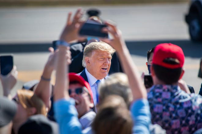 President Donald Trump greets supporters as he arrives on Air Force One at John Wayne Airport on Sunday, Oct. 18, 2020 in Santa Ana, California, where he will attend a fundraiser at the home of Palmer Luckey on Lido Island in Newport Beach. (Allen J. Schaben/Los Angeles Times/TNS)