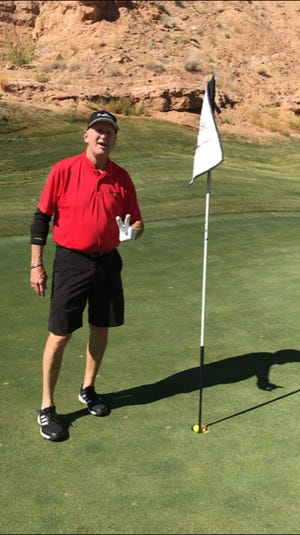 Longtime York County basketball official Dave Concino is recently shown holding up two fingers while his ball sits in the hole. Concino had just made a double eagle on a course in Nevada. A double eagle is a 3-under-par score on a par-5 hole. Concino needed just two shots to hole out.