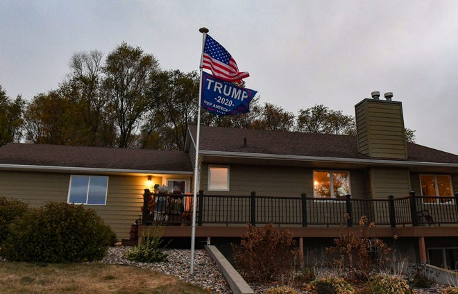 A flag supporting the Trump campaign flies outside a home on Tuesday, October 20, near Renner, SD.