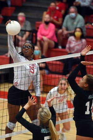 Vero Beach High School's Destiny Nelson goes up for a spike at the net on Wednesday, Oct. 21, 2020, during a regional quarterfinal playoff match against Gulf Coast High School in Vero Beach. Vero Beach won the match 22-25, 25-16, 25-16, 25-21 to advance to the next round.