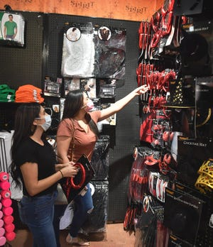 In this file photo, Vanessa Staresinic, left, and Aracely Garcia shop for costume accessories at Spirit Halloween. The COVID-19 pandemic caused a drop in retail business foot traffic like none other seen in most people's lifetimes. However, Texas retailers saw a less dramatic drop than some other states.