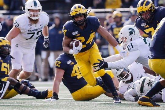Michigan running back Zach Charbonnet carries the ball during his team's 2019 game against Michigan State at Michigan Stadium.