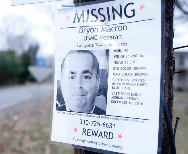 A flyer seeking information on missing Lafayette Township trustee Bryon Macron is posted on a light pole on Chippewa Road leading to Chippewa Lake where a body was recovered in the afternoon Tuesday,  Feb. 21, 2017 in Lafayette Township, Ohio. (Karen Schiely/Akron Beacon Journal)