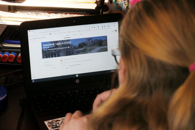 An Akron Public Schools student logs online for class in October. More students earned a failing grade in the first quarter, but the increase is not unique to Akron.