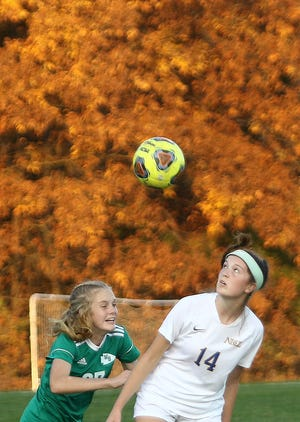 West Branch's Addyson Jones, left, and Notre Dame-Cathedral Latin's Ellie Znidarsic during playoff action at West Branch Thursday, October 22, 2020.