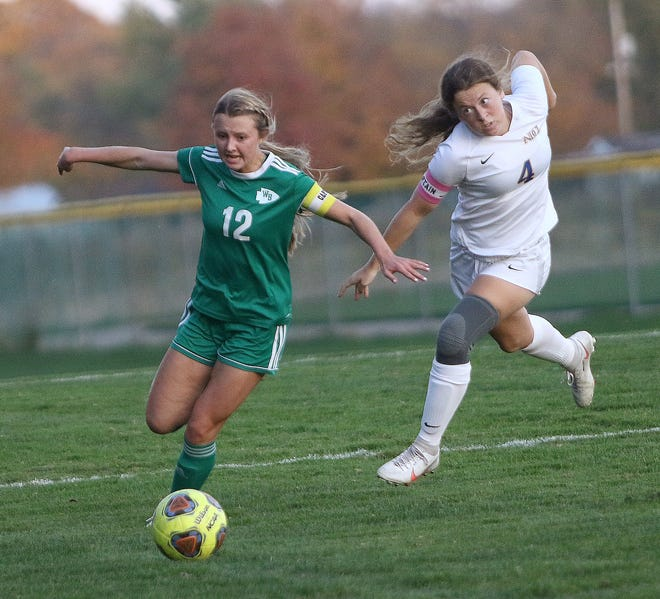 West Branch's Emma Eglie, left, breaks away from Notre Dame-Cathedral Latin's Meghan Hren during playoff action at West Branch Thursday, October 22, 2020.